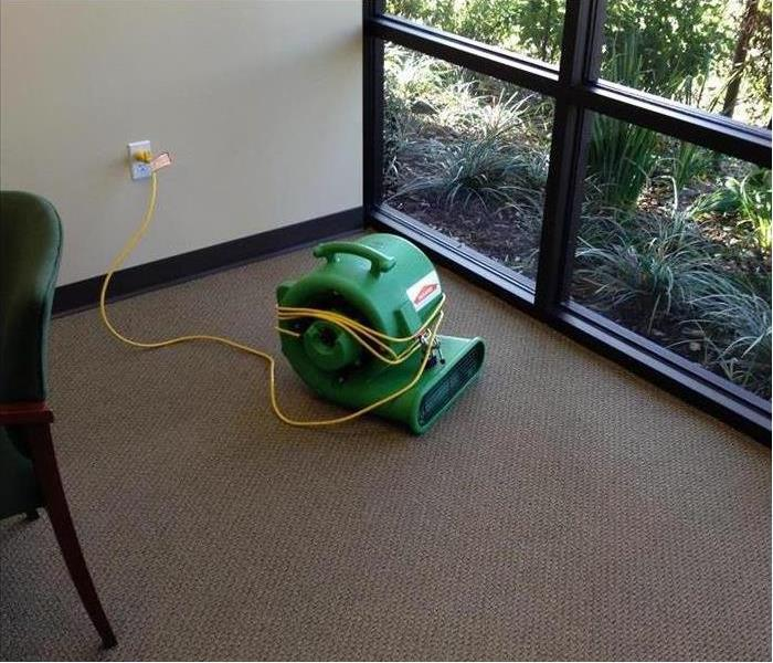 Photo of carpet with SERVPRO drying machine