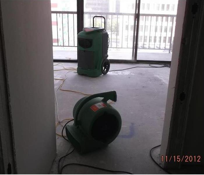 Photo of apartment building with SERVPRO drying equipment