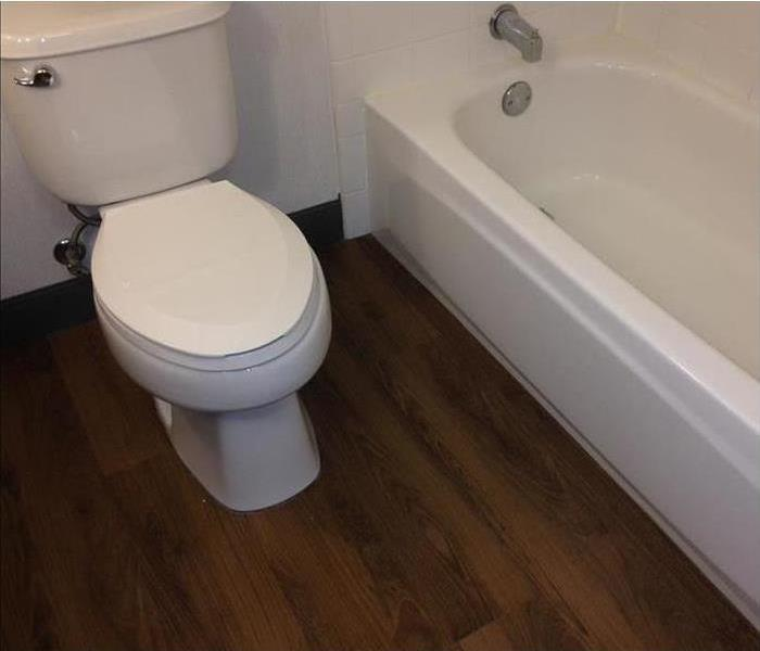 Photo of bathroom with toilet that's clean