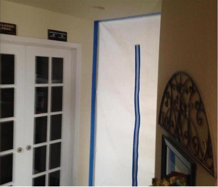 Plastic containment barriers with blue tape
