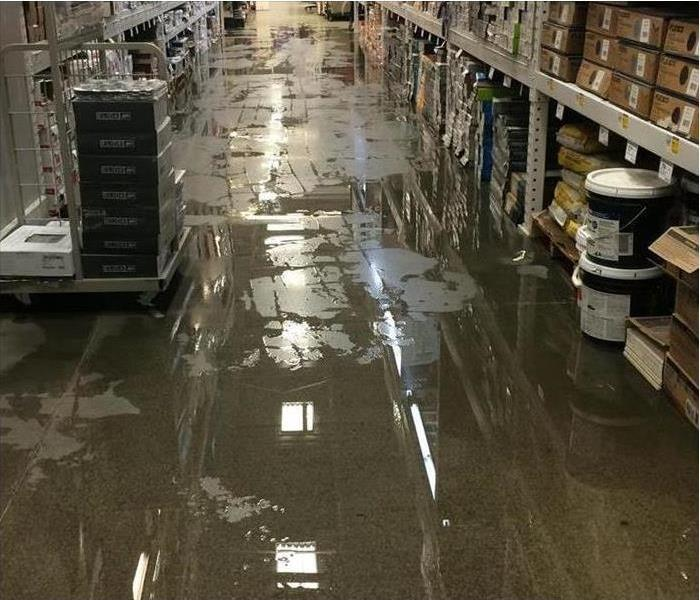 Photo of commercial area with water all over the grey floors