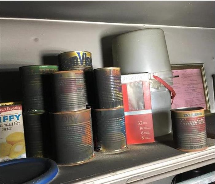 Cans of food covered in soot