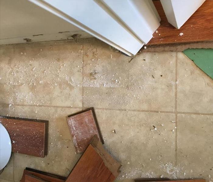 Tan tile with debris all over it